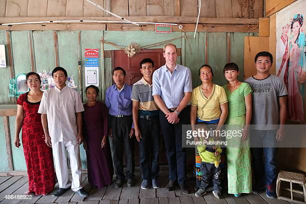 Prince William Duke of Cambridge meets the people of the Dai ethnic community as he visits Mengman village on March 4 2015 in Xishuangbanna China...