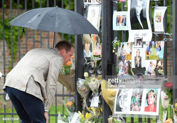 Prince William Duke of Cambridge meets well wishers and views tributes to Princeess Diana after a visit to The Sunken Garden at Kensington Palace on...