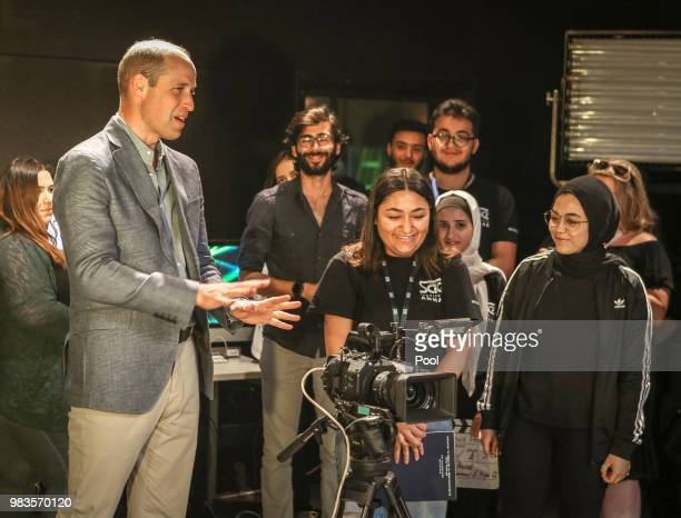 Prince William Duke of Cambridge meets young Jordanians and Syrian refugees during a visit to Al Quds College on June 25 2018 in Amman Jordan