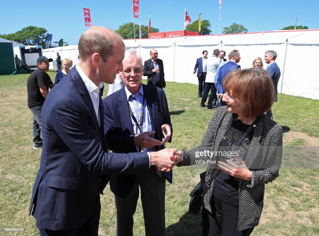 Prince William, Duke of Cambridge meets youth cycling coach Dot Tilbury MBE, who trained Mark Cavendish and Peter Kennaugh amongst others, as he attends the Isle of Man TT on June 6, 2018, Isle of Man, United Kingdom.