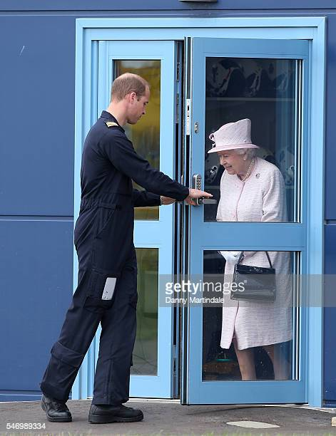 Prince William Duke of Cambridge opens the door for Queen Elizabeth II and Prince Philip Duke of Edinburgh during a tour as they open the new East...