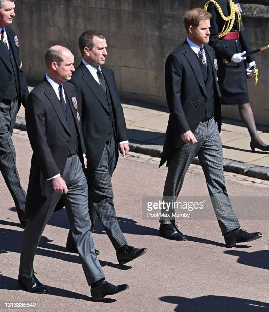 Prince William, Duke of Cambridge, Peter Phillips and Prince Harry, Duke of Sussex follow Prince Philip, Duke of Edinburgh's coffin during his...