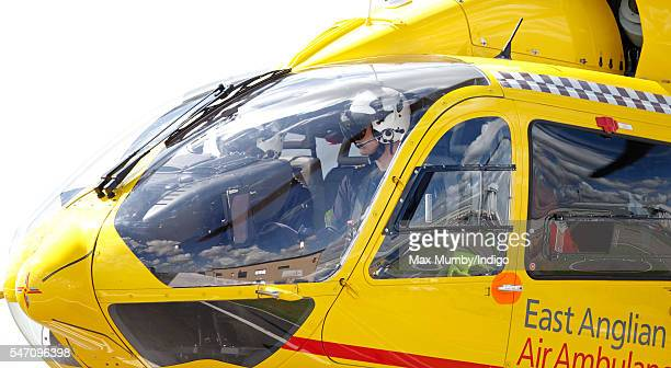 Prince William Duke of Cambridge pilots his air ambulance into land at the East Anglian Air Ambulance base at Cambridge Airport on July 13 2016 in...