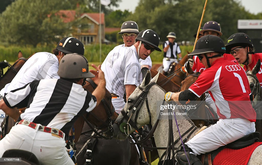 Prince William (C), Duke of Cambridge, plays during the Audi Polo Challenge 2015 at Cambridge County Polo Club on July 3, 2015 in Cambridge, England.