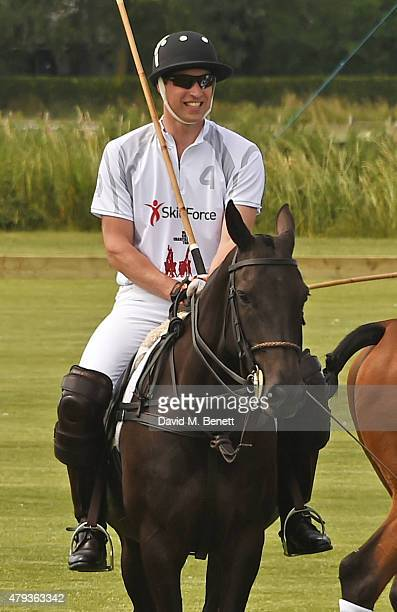 Prince William Duke of Cambridge plays during the Audi Polo Challenge 2015 at Cambridge County Polo Club on July 3 2015 in Cambridge England
