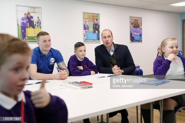 Prince William Duke of Cambridge plays Emoji Bingo with player of Everton FC Jordan Pickford and kids of Springwell Park Community Primary School...