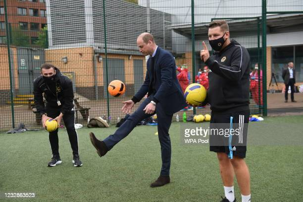 Prince William, Duke of Cambridge plays football during a visit to The Way Youth Zone on May 13, 2021 in Wolverhampton, England.