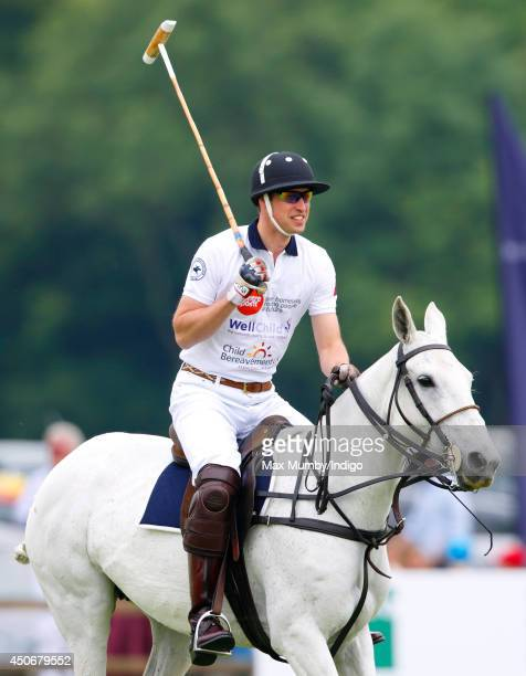 Prince William Duke of Cambridge plays in the Jerudong Trophy charity polo match at Cirencester Park Polo Club on June 15 2014 in Cirencester England