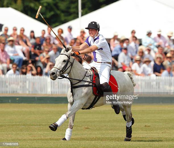 Prince William Duke of Cambridge plays in the Jerudong Trophy polo match at Cirencester Park Polo Club on July 14 2013 in Cirencester England