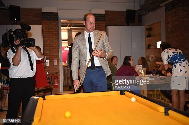 Prince William Duke of Cambridge plays pool during a visit to Youthscape on August 24 2016 in Luton England The Duke and Duchess visited Youthscape...