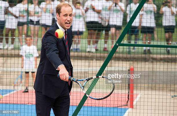 Prince William Duke of Cambridge plays tennis during an official visit to the Coventry War Memorial Park on July 16 2014 in Coventry England The Duke...
