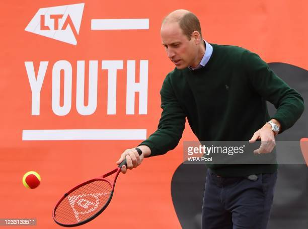 Prince William, Duke of Cambridge plays tennis games with local schoolchildren as he takes part in the Lawn Tennis Association's Youth programme, at...