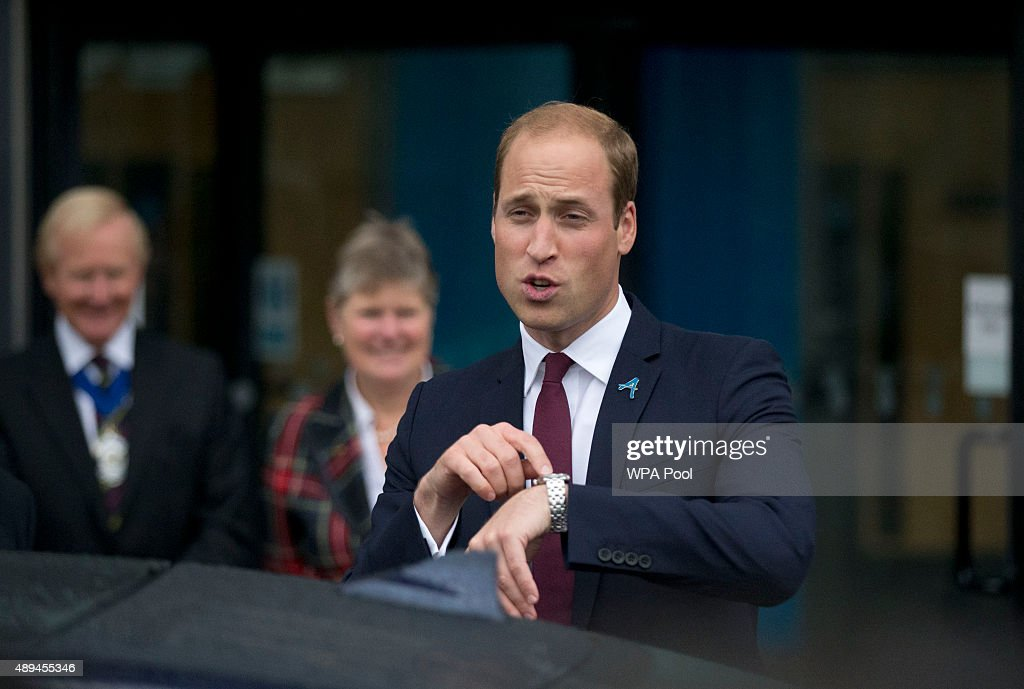 Prince William, Duke Of Cambridge points at his watch as he leaves his visit to Hammersmith Academy to support the Diana Award's #Back2School Anti-bullying Campaign #Back2School on September 21, 2015 in London, England. The Diana Award was set up in memory of Prince William's mother Diana Princess of Wales.