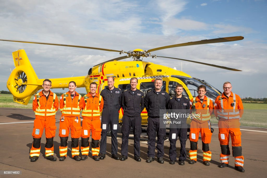 Prince William, Duke of Cambridge (4L) poses for a final photo with both day and night shift crews (from L - R) CCP Gary Spitzer, Dr Karen rhodes, Dr Adam Chesters, Cpt Matt Sandbach, Cpt Dave Kelly, Pilot Olly Gates, Dr Tobias Gouse and Ccp Carl Smith as he starts his final shift with the East Anglian Air Ambulance based out of Marshall Airport on July 27, 2017 near Cambridge, England.