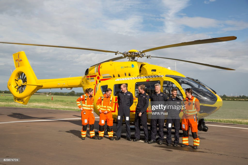 Prince William, Duke of Cambridge (4L) poses for a final photo with both day and night shift crews (from L - R) Dr Karen rhodes, Dr Adam Chesters, Cpt Matt Sandbach, Cpt Dave Kelly, Pilot Olly Gates and Dr Tobias Gouse as he starts his final shift with the East Anglian Air Ambulance based out of Marshall Airport on July 27, 2017 near Cambridge, England.