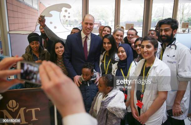 Prince William Duke of Cambridge poses for a picture with medical students as he visits Evelina London Children's Hospital to launch a nationwide...