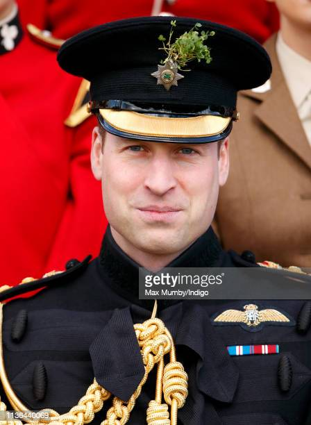 Prince William Duke of Cambridge poses for a regimental photograph as he attends the 1st Battalion Irish Guards St Patrick's Day Parade at Cavalry...