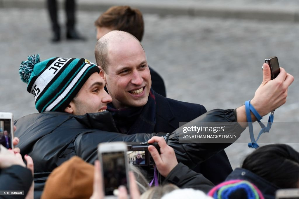 prince-william-duke-of-cambridge-poses-for-aselfie-photo-with-a-as-picture-id912198008