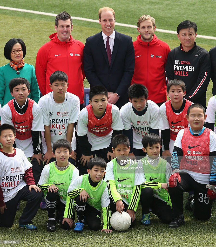 Prince William, Duke of Cambridge poses with children as he attends a Premier Skills Football Event on March 3, 2015 in Shanghai, China. Prince William, Duke of Cambridge is on a four day visit to China. He is the most senior royal to visit China since the Queen and Duke of Edinburgh in 1986. His visit follows on from a successful four day visit to Japan