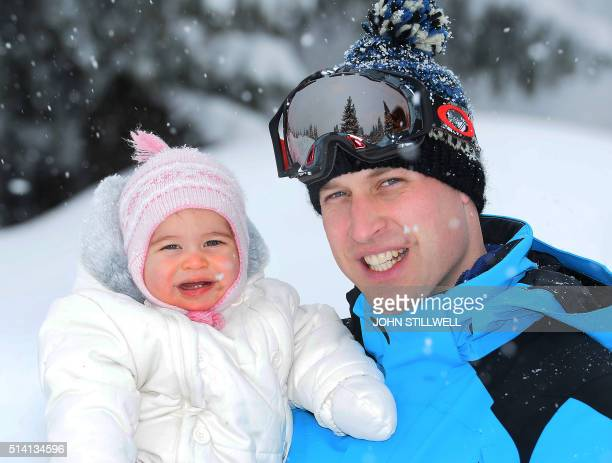 Prince William Duke of Cambridge poses with his daughter Princess Charlotte during a private break skiing at an undisclosed location in the French...