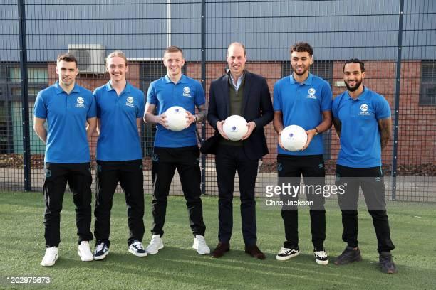 Prince William Duke of Cambridge poses with players of Everton FC Seamus Coleman Tom Davies Jordan Pickford Theo Walcott and Dominic CalvertLewin...