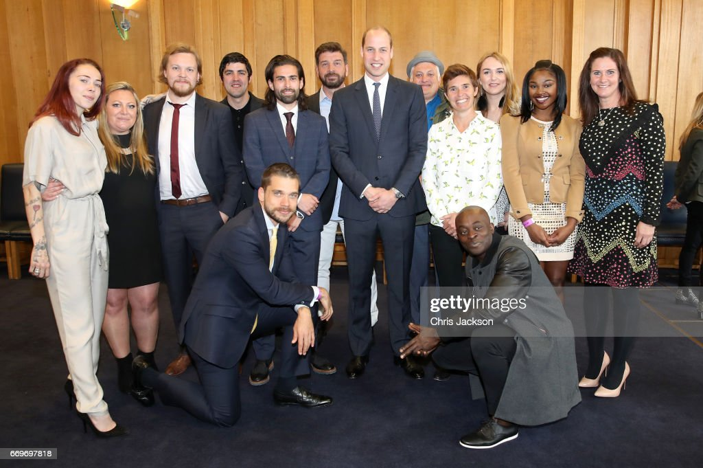Prince William, Duke of Cambridge (C) poses with runners who feature in the documentary as he attends a reception ahead of the screening of the BBC documentary 'Mind over Marathon' at BBC Radio Theatre on April 18, 2017 in London, England. The screening also launches the BBC season on mental health.