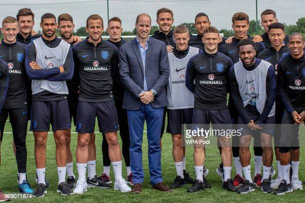 Prince William Duke of Cambridge poses with the England players including Captain Harry Kane as he attends the Facility at the FA Training Ground to...