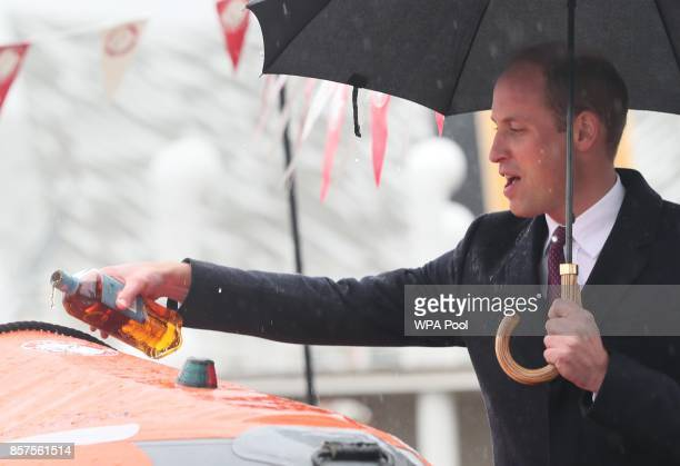 Prince William Duke of Cambridge pours some Bushmills Whisky over a life boat as he names it 'The Ray of Hope' for Lagan Search and Rescue a rescue...