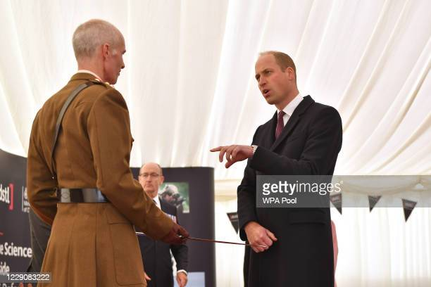 Prince William Duke of Cambridge presents British Army Colonel Mike Duff Assistant Commander South West and deputy joint commander for the...