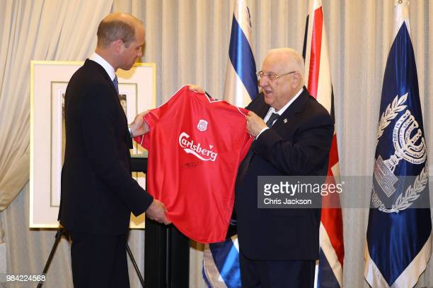 Prince William, Duke of Cambridge presents Israeli President Reuven Rivlin with a Liverpool FC shirt, signed by Steven Gerrard, during his official...