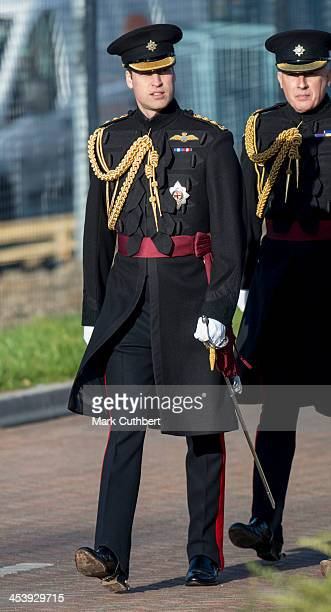 Prince William Duke of Cambridge presents medals to 1st Battalion Irish Guards at Mons Barracks on December 6 2013 in Aldershot England
