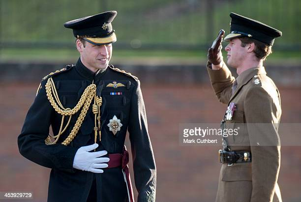 Prince William, Duke of Cambridge presents medals to 1st Battalion Irish Guards at Mons Barracks on December 6, 2013 in Aldershot, England.