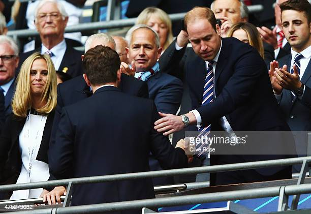 Prince William, Duke of Cambridge presents Tim Sherwood manager of Aston Villa with a runners-up medal after the FA Cup Final between Aston Villa and...