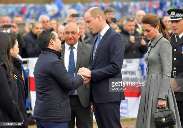 Prince William Duke of Cambridge President of the Football Association and Catherine Duchess of Cambridge are greeted by Leicester City Vice chairman...