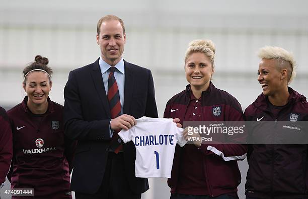 Prince William, Duke of Cambridge, President of the Football Association, is given an England shirt for Princess Charlotte during a visit to the...