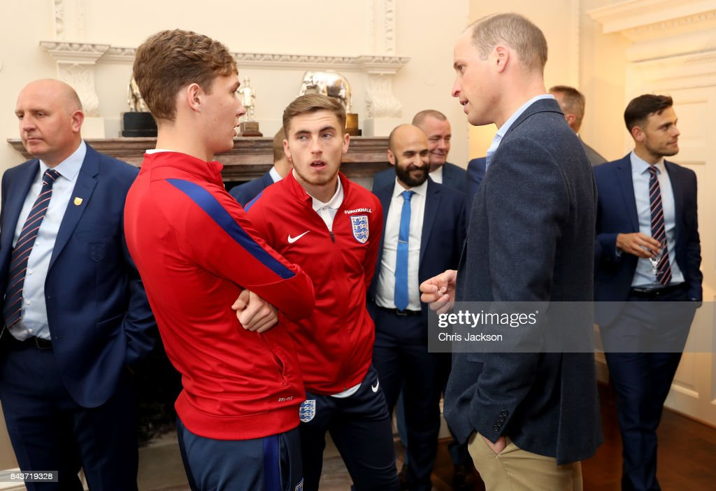 Prince William, Duke of Cambridge (R) President of the Football Association, speaks with Kieran Dowell (L) and Jonjoe Kenny (C) during a reception for the Under-20 England Football Team at Kensington Palace on September 7, 2017 in London, England. The England Under-20 side became the first England team to win a football World Cup since 1996 when they beat Venezuela 1-0 on June 11th, 2017.
