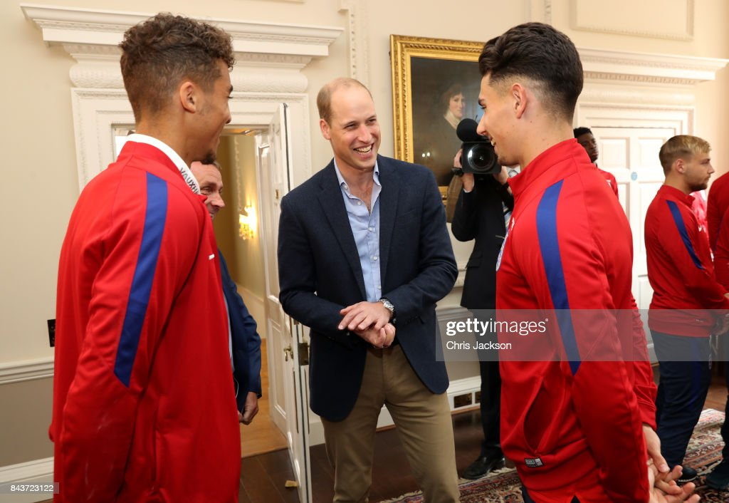 Prince William, Duke of Cambridge (C) President of the Football Association, speaks with Dominic Calvert-Lewin (L) and Luke Southwood (R) during a reception for the Under-20 England Football Team at Kensington Palace on September 7, 2017 in London, England. The England Under-20 side became the first England team to win a football World Cup since 1996 when they beat Venezuela 1-0 on June 11th, 2017.