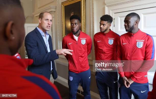 Prince William Duke of Cambridge President of the Football Association speaks with Josh Onomah Jake ClarkeSalter and Fikayo Tomori during a reception...