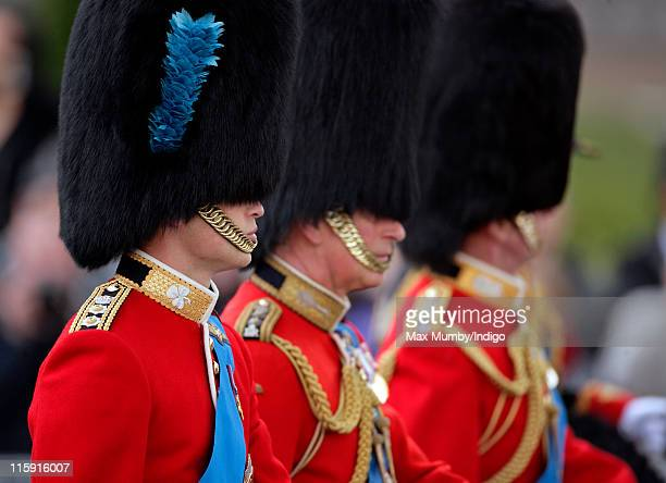 Prince William Duke of Cambridge Prince Charles Prince of Wales and Prince Edward Duke of Kent ride horses as they take part in the Trooping the...