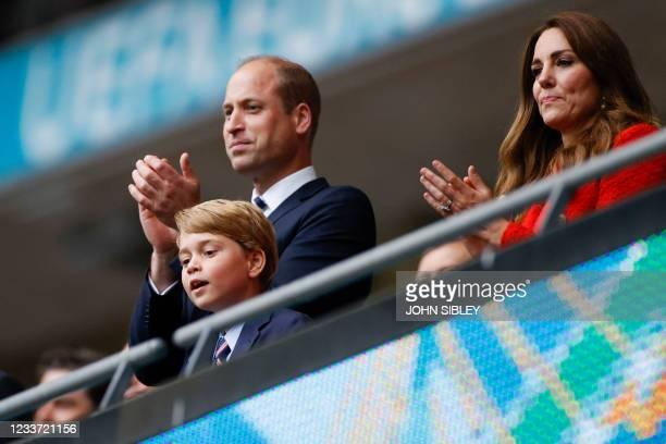 Prince William, Duke of Cambridge, Prince George of Cambridge, and Catherine, Duchess of Cambridge, celebrate the win in the UEFA EURO 2020 round of...
