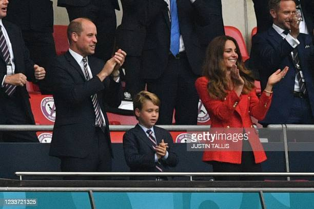 Prince William, Duke of Cambridge, Prince George of Cambridge, and Catherine, Duchess of Cambridge, celebrate the first goal in the UEFA EURO 2020...