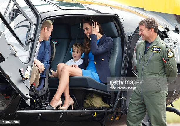 Prince William, Duke of Cambridge, Prince George of Cambridge and Catherine, Duchess of Cambridge sit in a Squirrel helicopter as they visit the...