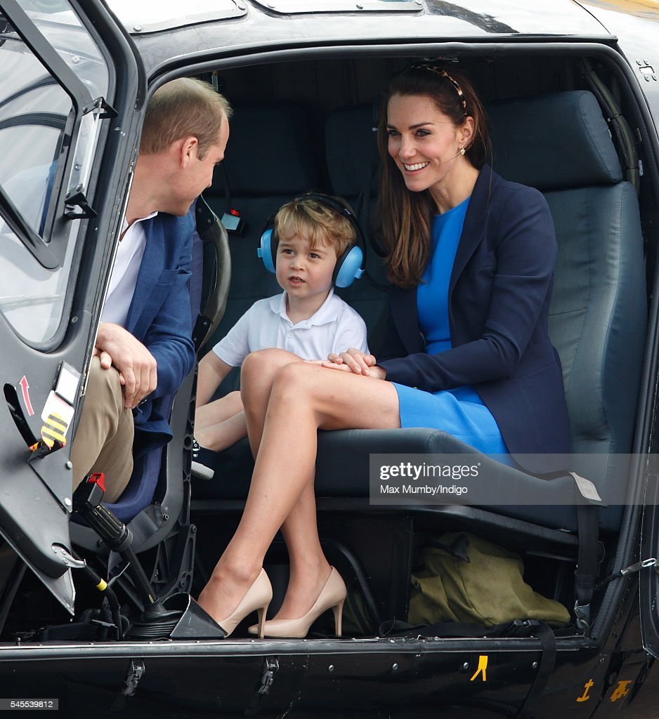 Prince William, Duke of Cambridge, Prince George of Cambridge and Catherine, Duchess of Cambridge sit in a Squirrel helicopter as they visit the Royal International Air Tattoo at RAF Fairford on July 8, 2016 in Fairford, England.