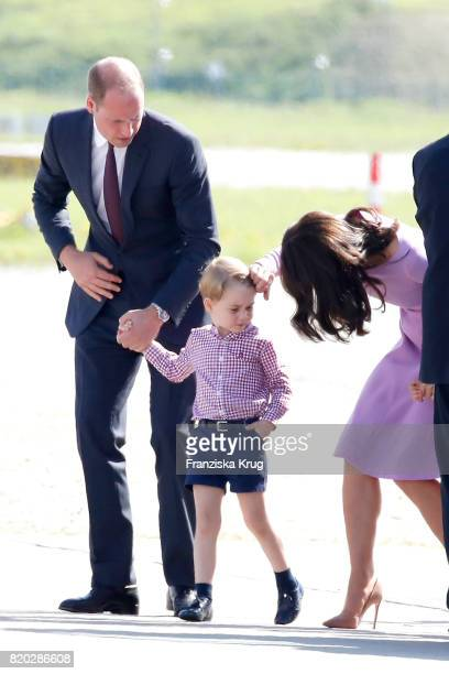 Prince William Duke of Cambridge Prince George of Cambridge and Catherine Duchess of Cambridge view helicopter models H145 and H135 before departing...