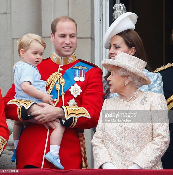Prince William Duke of Cambridge Prince George of Cambridge Catherine Duchess of Cambridge and Queen Elizabeth II stand on the balcony of Buckingham...