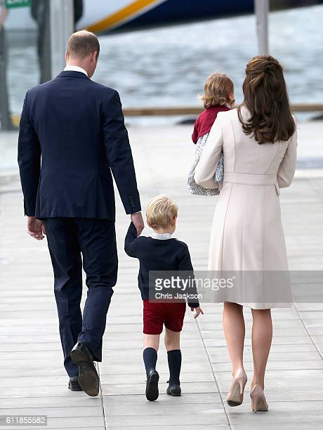 Prince William, Duke of Cambridge, Prince George of Cambridge, Catherine, Duchess of Cambridge and Princess Charlotte wave as they leave from...
