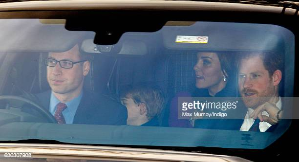 Prince William Duke of Cambridge Prince George of Cambridge Catherine Duchess of Cambridge and Prince Harry attend a Christmas lunch for members of...