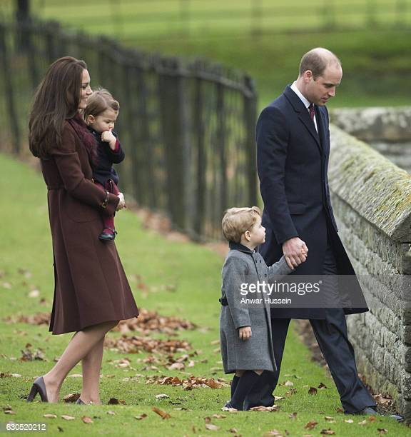 Prince William, Duke of Cambridge, Prince George of Cambridge, Catherine, Duchess of Cambridge and Princess Charlotte of Cambridge attend a Christmas...