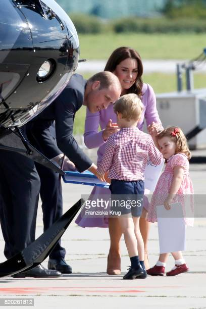 Prince William Duke of Cambridge Prince George of Cambridge Princess Charlotte of Cambridge and Catherine Duchess of Cambridge view helicopter models...