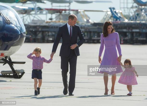 Prince William Duke of Cambridge Prince George of Cambridge Princess Charlotte of Cambridge and Catherine Duchess of Cambridge depart from Hamburg...